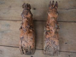 PAIR OF ANTIQUE HORSE HEAD CARVINGS FROM THE CORNERS OF A HAVELI DOORWAY <b>SOLD<b>